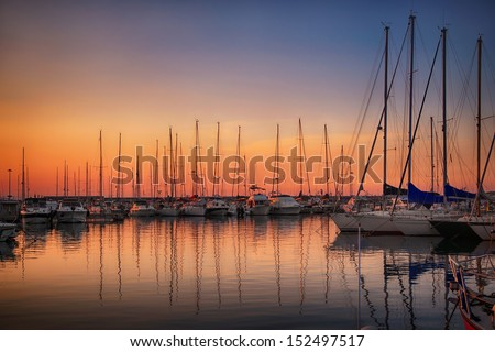 Marina with docked yachts at sunset in Giulianova, Italy - stock photo