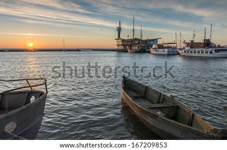 Marina with fishing and pleasure boats in Nida - famous resort village in Curonian spit, Lithuania, Europe - stock photo