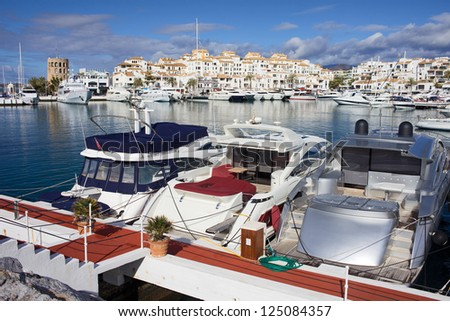 Marina with luxury yachts in resort town of Puerto Banus on Costa del Sol in Spain, near Marbella, Andalusia region. - stock photo