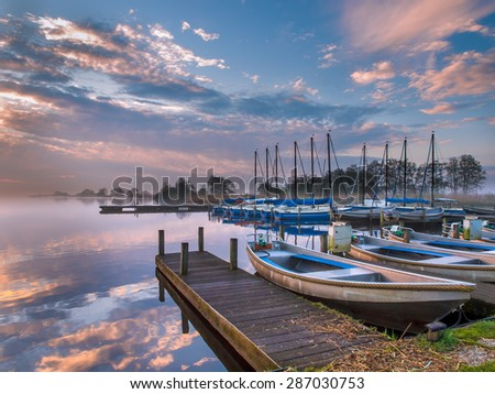 Marina with rental boats  in the early morning - stock photo