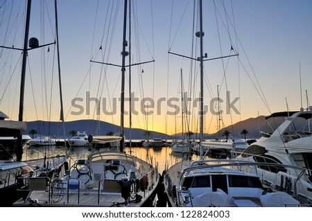 Marina with yachts on sunset - stock photo