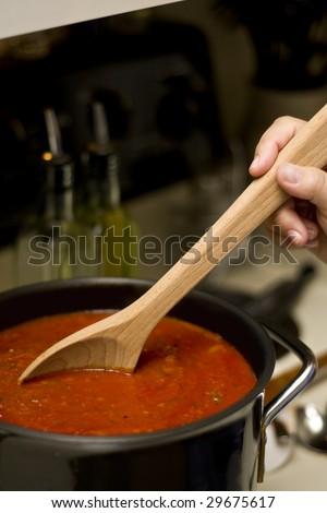 Marinara sauce on the stove - stock photo