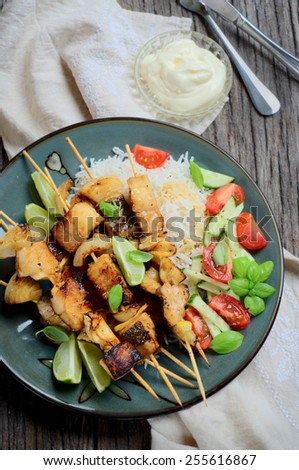 marinated and grilled barramundi skewers with rice and fresh salsa on a garnish. selective focus - stock photo