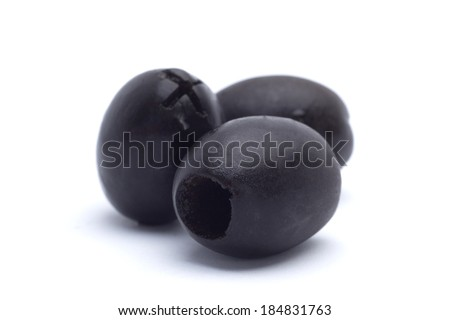 Marinated black pitted olive closeup isolated on white background - stock photo