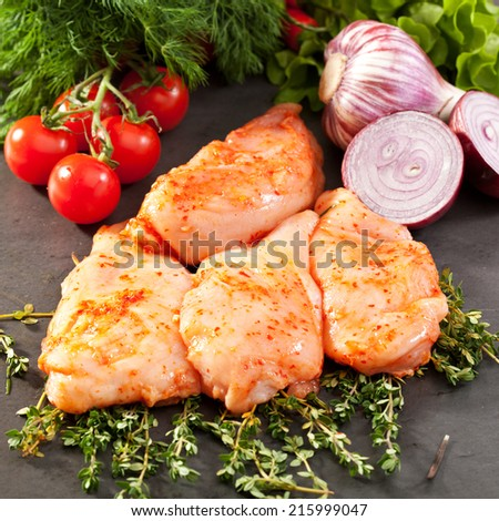 Marinated Chicken Breast with Rosemary and Vegetables - stock photo