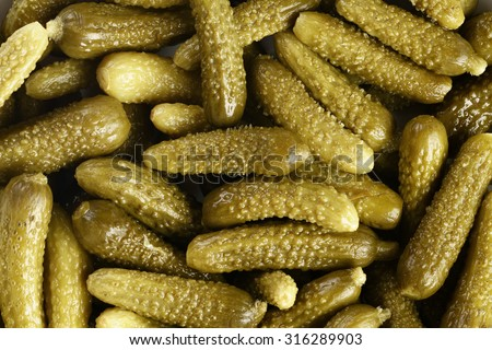 marinated cornichons shot from above, for food background - stock photo