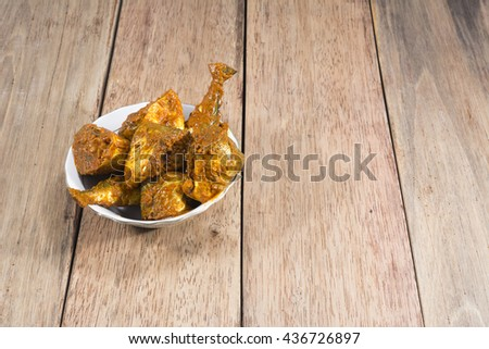 Marinated fish mixed in indian spices ready for cooking - south indian Cuisine - India.  - stock photo