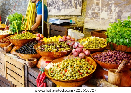 Marinated garlic and olives on provencal street market in Provence, France. Selling and buying. - stock photo