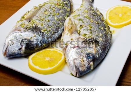 Marinated gilthead fishes ready to bake - stock photo