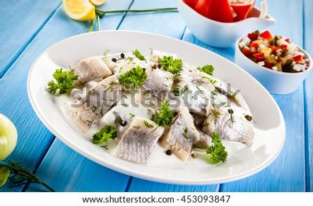 Marinated herring fillets in cream  - stock photo