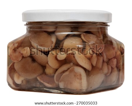 Marinated mushrooms in glass jar isolated on white background. The canned food. - stock photo