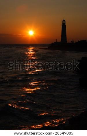 marine beacon at sunset - stock photo