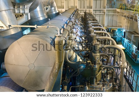 Marine engine of the large container ship - stock photo