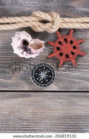 Marine knot on wooden background - stock photo