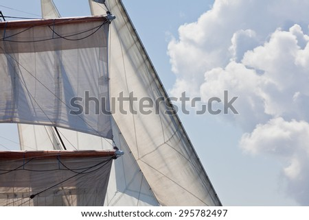 Marine sailing nautical abstract background showing detail of a three masted barquentine yacht square rigged on the foremast - stock photo