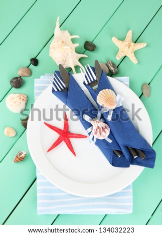 Marine table setting on color wooden background - stock photo