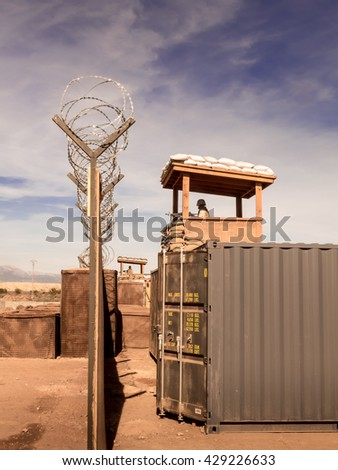 Marines soldiers watching from their military camp - stock photo