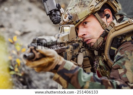 marines with a rifle aiming at a target - stock photo