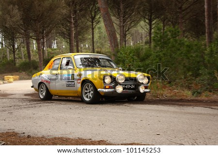 MARINHA GRANDE, PORTUGAL - APRIL 14: Vitor Torres drives a Ford Escort during Rally Vidreiro 2012, integrated on Open Championship in Marinha Grande, Portugal on April 14, 2012. - stock photo