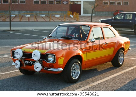 """MARINHA GRANDE, PORTUGAL - FEBRUARY 11: A Ford Escort MKI parked during """"12th Classic and Sport Cars Meeting of Motor Club Of Marinha Grande"""", in Marinha Grande, Portugal on February 11, 2012. - stock photo"""