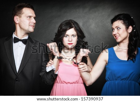 marital infidelity concept. Love triangle two women one man passion of love hate. Mistress betrayal within the family. Black background - stock photo
