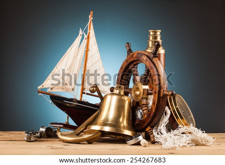 maritime adventure marine gadgets on wooden table - stock photo