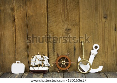 Maritime decoration - voucher for a cruising journey on a wooden background.  - stock photo