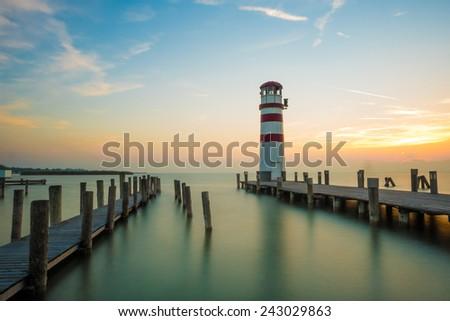 Maritime lighthouse sunset - stock photo