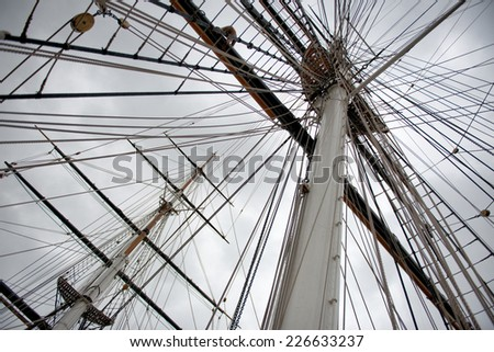 Maritime Naval Rigging of an old merchant clipper, with the spars, mast and pulleys - stock photo