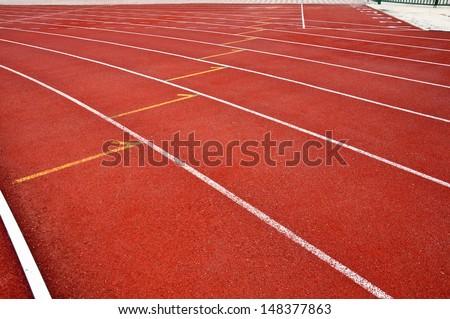 Mark for exchange tube on running track - stock photo