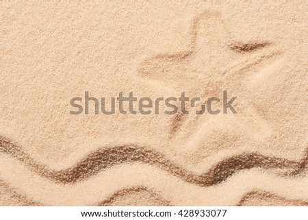 Mark of starfish and wave on sand. Summer beach background. View from above - stock photo