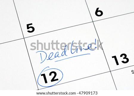 Mark the deadline on the business calendar - stock photo