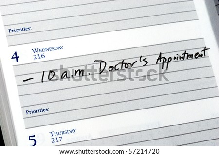 Mark the doctor appointment in the day planner - stock photo