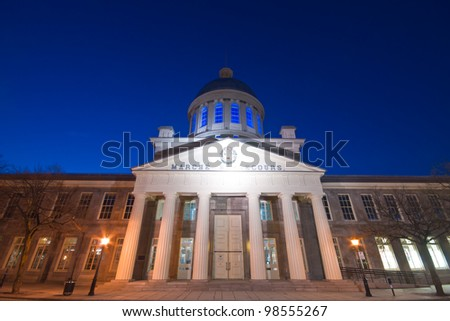 Market Bonsecour facade at dusk, with the dome illuminated in blue. - stock photo