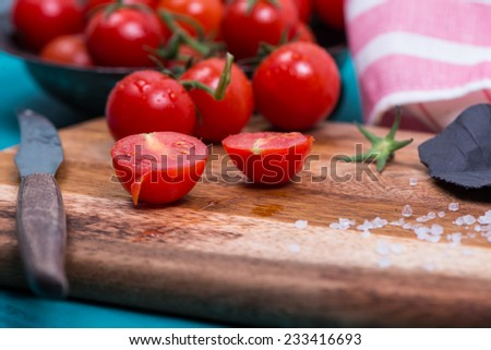 market fresh cherry tomatoes with sea salt on table - stock photo