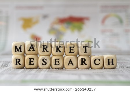 Market Research word built with letter cubes - stock photo
