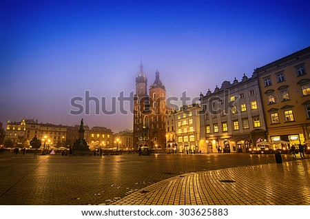 Market square in Cracow at night with St. Mary's Basilica - stock photo