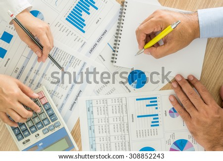 marketer worker analyzing statistical data on desk in office. top view - stock photo