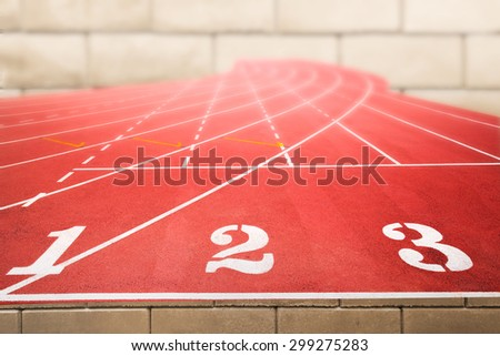 Marketing and business competition and positioning concept for advertisment background on running tracks One Two Three with pale blurred brick wall - stock photo