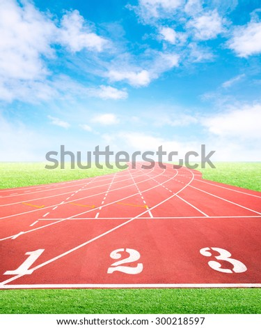 Marketing and business competition positioning concept for advertisement background on running tracks One Two Three with green grass field and blue sky - stock photo