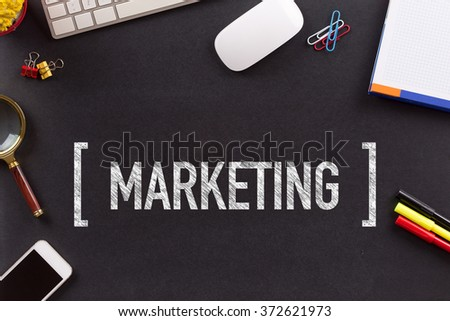 MARKETING CONCEPT ON BLACKBOARD - stock photo