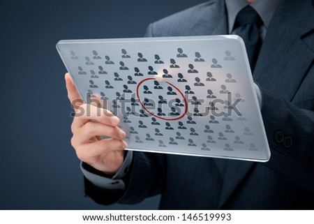 Marketing segmentation concept - businessman with futuristic glass tablet select segment (niche) of customers. Sales force team concept. - stock photo