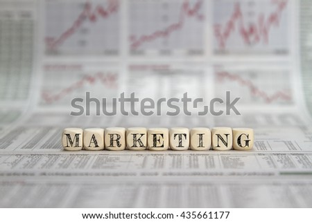 Marketing word on a newspaper background - stock photo