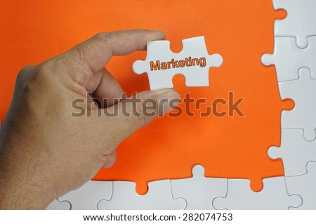 Marketing word on white puzzle - Business Concept - stock photo