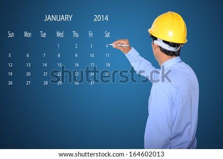 marking new year day on calendar January 2014. - stock photo