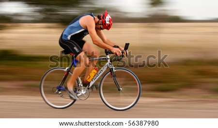 MARLEY POINT, VIC - CIRCA 2008: A unidentified triathlete competes in a triathlon at Marley point near Sale, Circa 2008 Marley Point, Vic, Australia, - stock photo