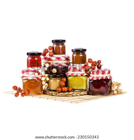 marmalade in many jars of various sizes with of different colors  isolated on white background - stock photo