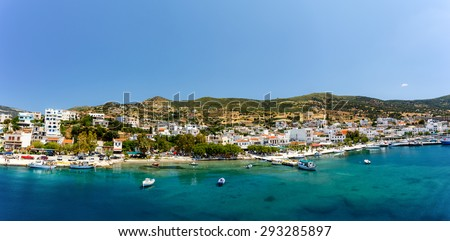 Marmari port with anchored fish boats against a blue sky and blue waters in Evia, Greece - stock photo