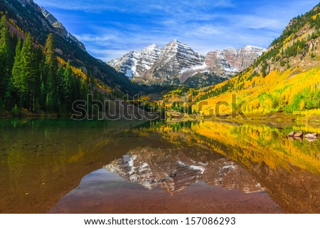 Maroon Bells and its Reflection in Maroon Lake  as Fall foliage in Peak at Aspen, Colorado - stock photo