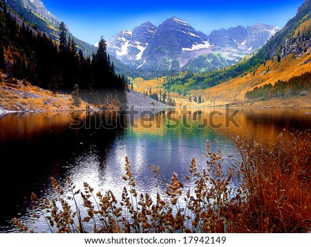 Maroon Bells Mountain Peaks reflected in Maroon Lake near Aspen Colorado - stock photo